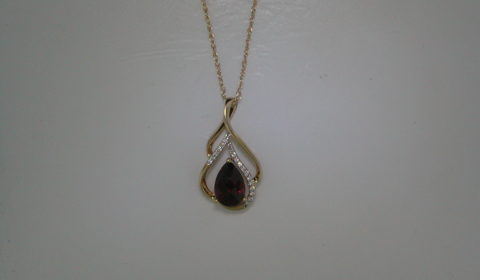 Garnet pear shape pendant in 14kt yellow gold =1.06ct with 17 diamonds =.06ct on an 18in chain.  Style 950-0144 $625.00