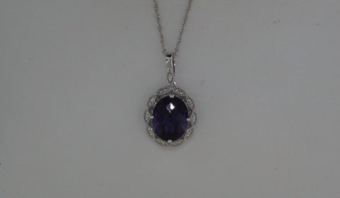 Amethyst oval pendant in 14kt white gold =2.16ct with 11 diamonds =.04ct on an 18in chain.  Style 950-0145 $625.00