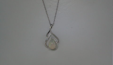 Opal pear shape pendant in 14kt white gold =.76ct with 17 diamonds =.05ct on an 18in chain.  Style 950-0146 $825.00