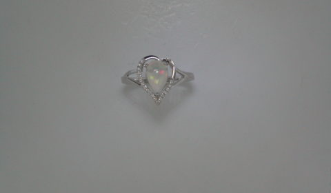 Opal pear shape ring in 14kt white gold =.75ct with 19 diamonds =.08ct.  Style 950-0147 $825.00