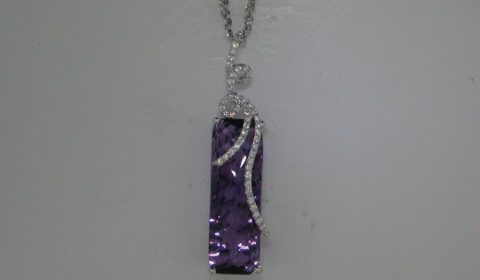 Amethyst mixed cut pendant in 14kt white gold =6.60ct with 51 diamonds =.19ct on an 18in chain.  Style 950-0148 $1775.00