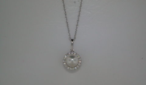 6.5-7mm freshwater pearl pendant in 14kt white gold with 19 diamonds =.15ct on an 18in chain.  Style 950-0149 $850.00