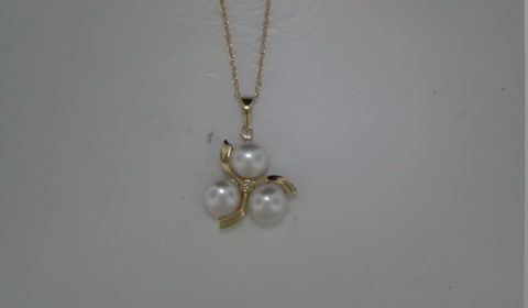 7-7.5mm Button pearls (3) pendant in 14kt yellow gold with one diamond =.01ct on an 18in chain.  Style 950-0153 $395.00