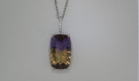 Ametrine  Pendant in 14kt white gold =18.47ct with 63 diamonds =.39ct on an 18in chain.  Style 950-0155 $3000.00
