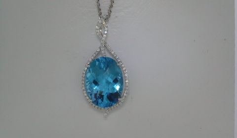 Blue topaz oval pendant in 14kt white gold =19.45ct with 69 diamonds =.48ct on an 18in chain.  Style 950-0156 $3000.00