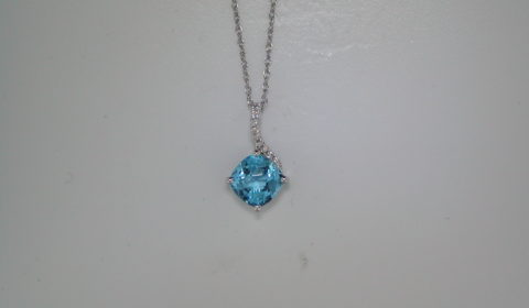 Checkerboard cut 7mm blue topaz pendant in 14kt white gold =1.42ct with 9 diamonds =.05ct Style 950-0160 $575.00