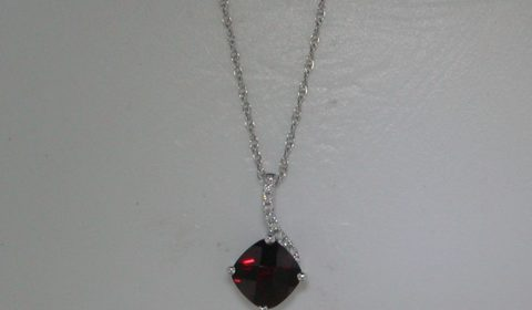 Checkerboard cut 7mm garnet pendant in 14kt white gold =1.64ct with 9 diamonds =.05ct..  Style 950-0162 $575.00