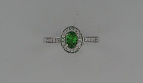 Ladies Tsavorite ring in 14kt white gold =.44ct, with 26 diamonds =.25ct.  Style 135-0196 $2100.00