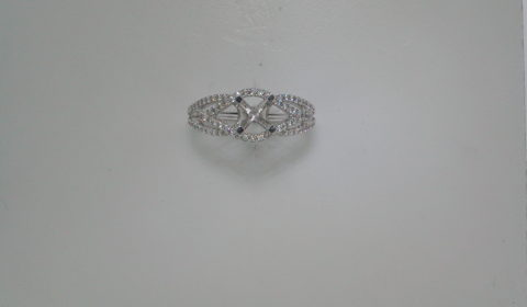 Semi-mount wedding ring in 14kt white gold with 100 diamonds =.65ct.  Style 135-0213 $2200.00