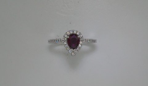 Ladies pear shape ruby ring in 14kt white gold =.77ct, with 45 diamonds =.38ct. Style 135-0214 $3000.00