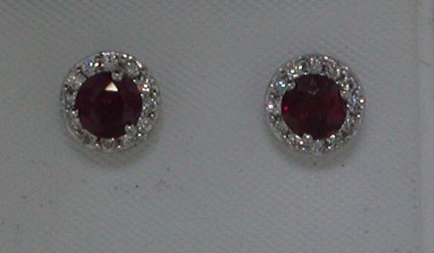 Ruby earrings in 14kt white gold =1.25ct with 24 diamonds =.25ct.  Style 135-0217 $3100.00