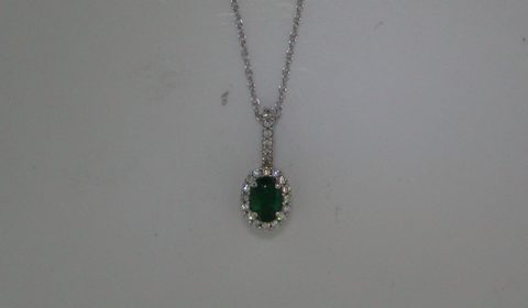 Emerald pendant in 14kt white gold =.45ct, with 23 diamonds =.18ct on an 18in chain.  Style P6816WE1901 $1250.00