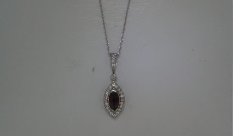 Marquise ruby pendant in 14kt white gold =.85ct, with 25 diamonds =.32ct on an 18in chain.  Style 135-0219 $2300.00