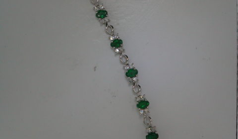 Emerald bracelet in 14kt white gold with 13 emeralds =2.80ct and 52 diamonds =1.20ct.  Style 135-0223 $4570.00