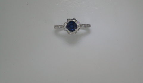 Ladies sapphire ring in 14kt white gold =.81ct with 34 diamonds =.40ct.  Style 135-0227 $2650.00