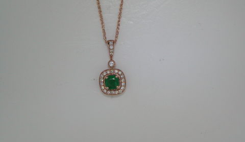 Emerald pendant in 14kt rose gold =.40ct with 23 diamonds =.20ct on an 18in chain.  Style 135-0228 $2000.00