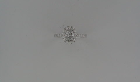 Oval halo engagement ring in 14kt white gold =.92ct with 36 round diamonds =.50ct.  Style 700-0388 $5995.00