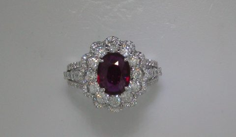Ladies ruby oval ring in 18kt white gold =1.76ct with 102 round diamonds =1.43ct.  Style 31701-18W $10250.00