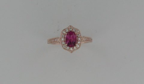 Pink tourmaline ring in 14kt rose gold =.76ct with 30 diamonds =.23ct.  Style 71887 $1800.00