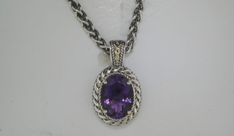 Amethyst pendant in sterling silver and 14kt yellow gold =5.75ct on an 18in chain.  Style 800-2138 $375.00