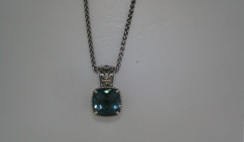London blue topaz pendant in sterling silver and 14kt yellow gold =4.20ct on an 18in chain.  Style 800-2141 $195.00