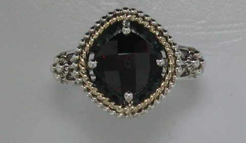 Ladies garnet ring in sterling silver and 14kt yellow gold =2.38ct.  Style 800-2149 $195.00