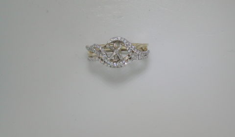 14kt yellow and white gold bridal set with 77 diamonds =.34ct.  Style 723-0033.  $3000.00