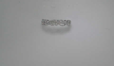 Stackable band in 14k white gold with 9 diamonds =.06ct.  Style OB19A14/.50W.  $750.00