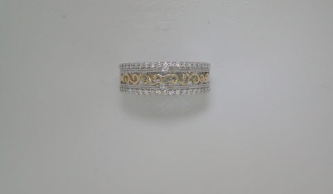 Diamond band in 14kt yellow and white gold with 38 diamonds =.33ct.  Style 723-0036.  $2000.00