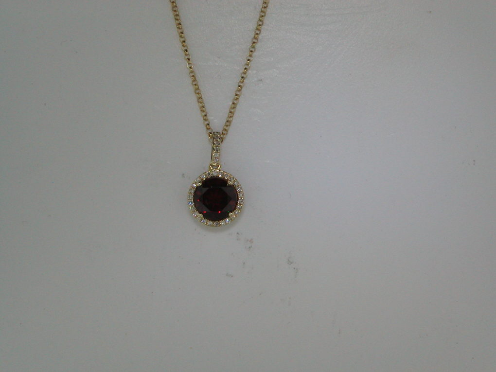 1.70ct garnet pendant in 14kt yellow gold with 32 diamonds =.08ct on a 16in chain.  Style 270-0082  $575.00