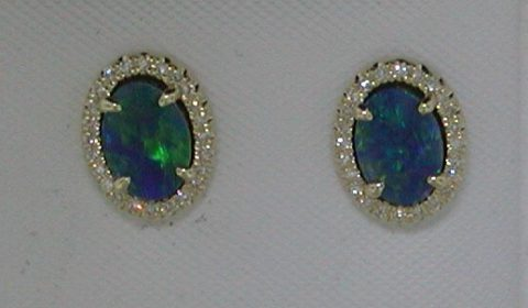 1.24ct bolder opal earrings in 14kt yellow gold with 48 diamonds =.12ct.  Style 270-0086 $695.00