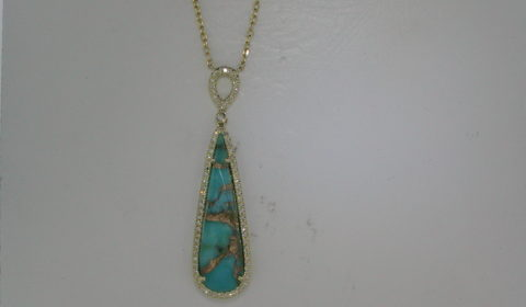 5.79ct turquoise pendant in 14kt yellow gold with 78 diamonds =.23ct on an 18in chain.  Style DC-N13082-3 $1295.00