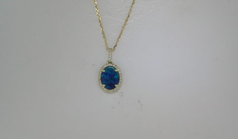 1.17ct boulder opal pendant in 14kt yellow gold with 32 diamonds =.09ct on a 16in chain.  Style 270-0089 $1000.00