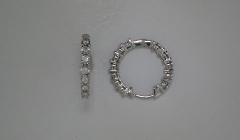 Illusion set hoop earrings in 14kt white gold with 24 diamonds =.50ct.  Style 412-0111.  $1500.00