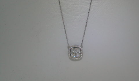Halo pendant in 14kt white gold with 31 diamonds =.50ct.  Style NK10083-4WC.  $1500.00