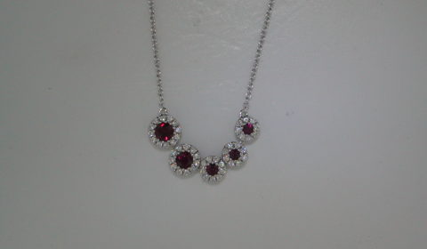 .79ct ruby pendant in 18kt white gold with 5 rubies and  50 diamonds =.38ct on an 18in chain  Style 135-0231 $3500.00