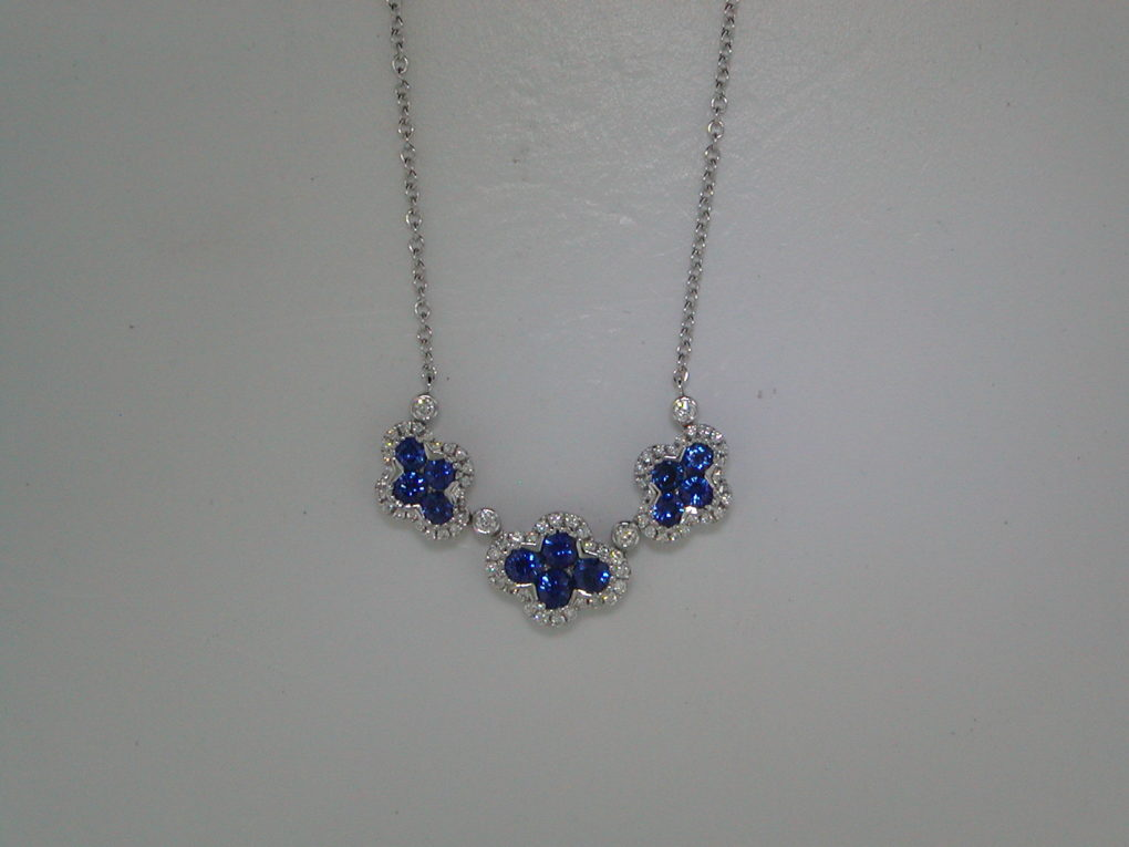 1.09ct sapphire pendant in 18kt white gold with 12 sapphires and 76 diamonds =.29ct on an 18in chain.  Style 135-0232  $3000.00