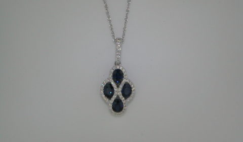 1.40ct sapphire pendant in 18kt white gold with 4 sapphires and 58 diamonds =.22ct on an 18in chain.  Style 135-0239  $1895.00