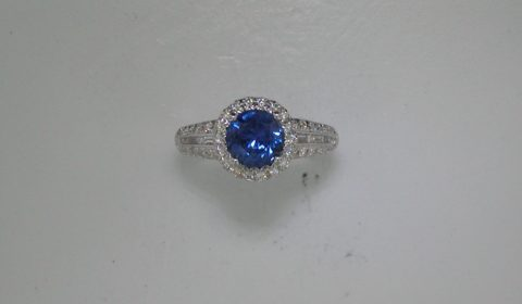 1.40ct sapphire ladies ring in 18kt white gold with 6 baguette and 46 round diamonds =.54ct  Style 135-0244  $5000.00