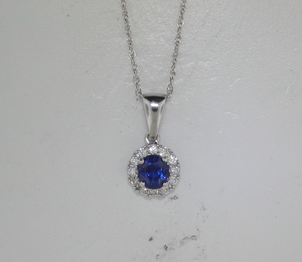 1.00ct sapphire pendant in 14kt white gold with 12 diamonds =.22ct on an 18in chain.  Style 135-0245 $1995.00