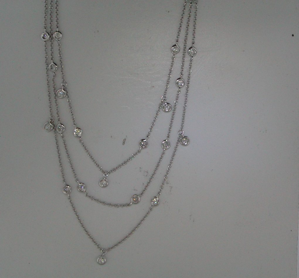 3 strand diamond by the yard necklace in 14kt white gold with 28 diamonds =.39ct.  Style 700-0409.  $1495.00