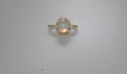 1.20ct ethiopian opal ladies ring in 14kt yellow gold with 20 diamonds =.14ct.  Style SDR1358.  $1400.00