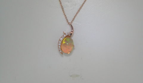 2.5ct Ethiopian opal pendant in 14kt rose gold with 10 diamond =.12ct on an 18in chain.  Style SDP3104.  $1350.00