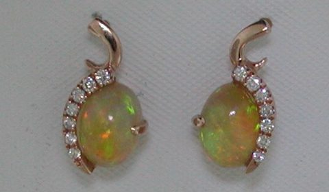 1.60ct Ethiopian opal earrings in 14kt rose gold with 14 diamonds =.16ct.  Style SDE3104.  $1000.00