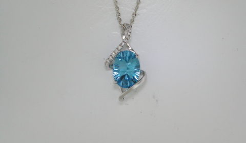 6.20ct blue topaz pendant set in 14kt white gold with 15 diamonds =.12ct on an 18in chain.  Style 907-0026.  $1450.00