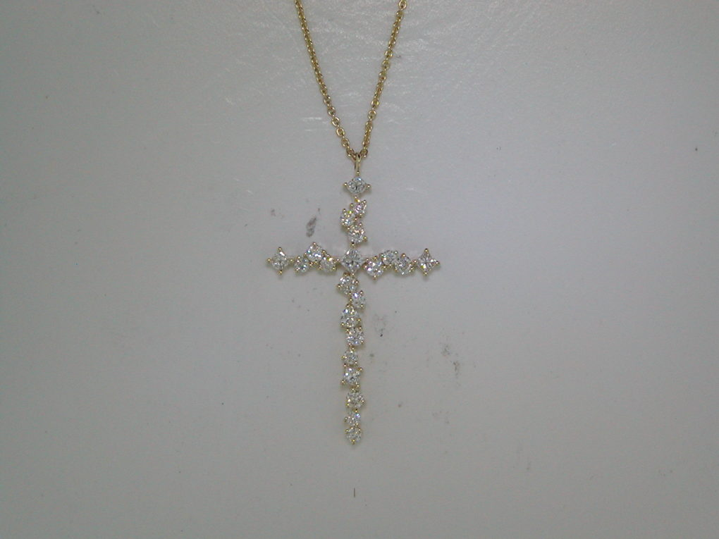 Cross pendant in 14kt yellow gold with 5 princess cut diamonds =.20ct, 17 round diamonds =.36ct on an 18in chain.  Style 842-0035.  Style 842-0035.  $2150.00.
