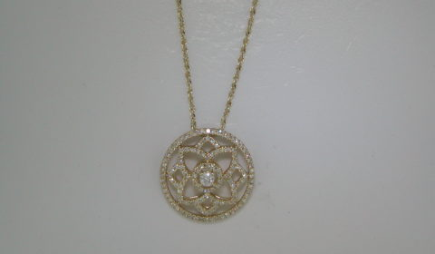 Circle pendant in 14kt yellow gold with 127 diamonds =.44ct on an 18in chain.  Style N1031. $1450.00