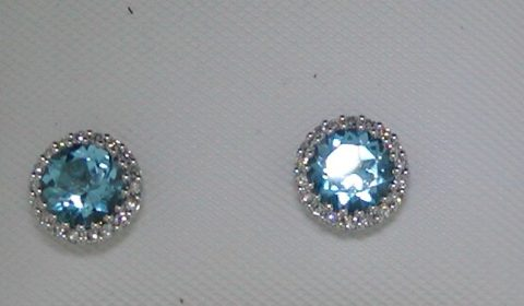 Blue topaz earrings set in 14kt white gold with 36 diamonds =.12ct.  Style 842-0038. $700.00