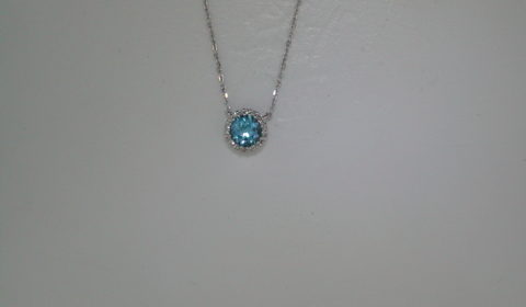 Blue topaz pendant set in 14kt white gold with 18 diamonds =.06ct on an 18in chain.  Style 842-0039. $600.00