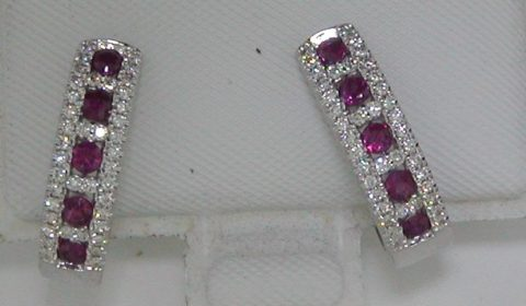 .51ct ruby loop earrings set in 14kt white gold with 80 diamonds =.27ct.  Style E357.  $2000.00